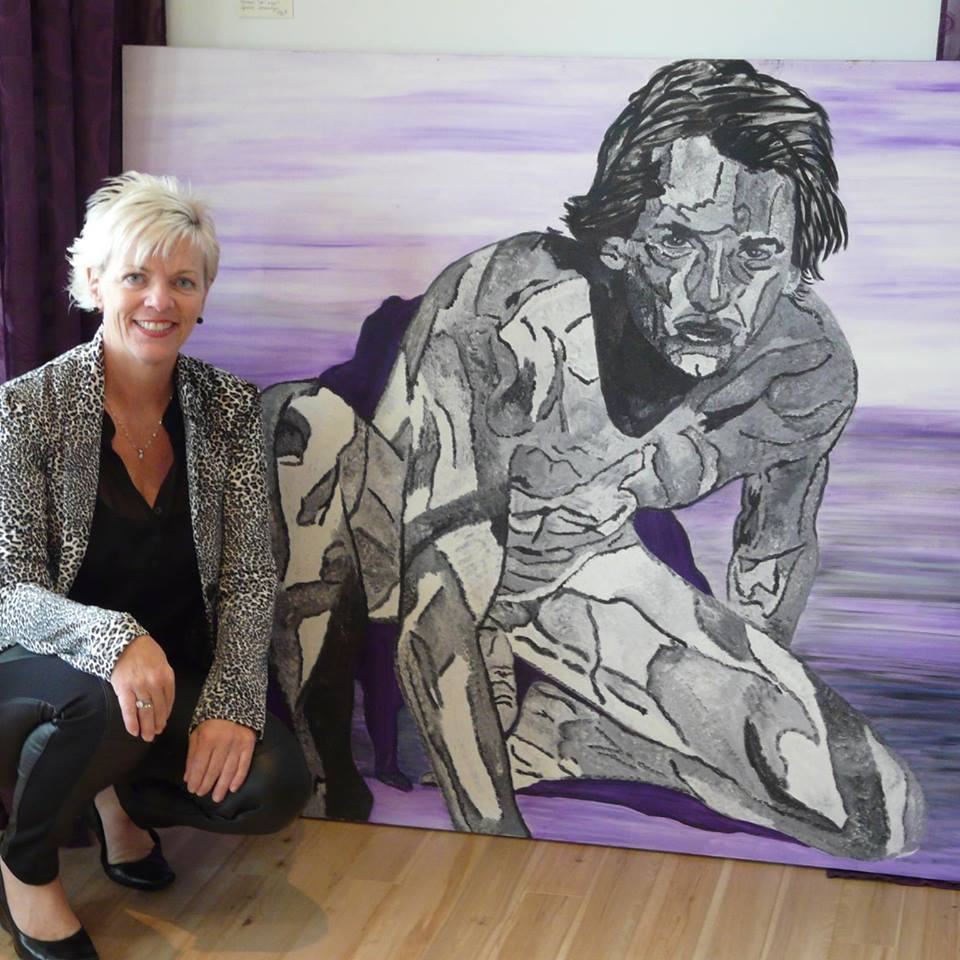 The artiste Louise Lajeunesse beside one of her Canvas